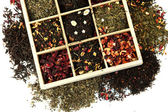 Assortment of dry tea in wooden box, isolated on white — Stock Photo