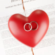 Stock Photo: Red heart with torn Divorce decree document, on wooden background close-up