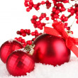 Beautiful red Christmas balls on snow, isolated on white — Stock Photo