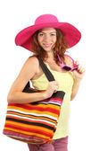 Smiling beautiful girl with beach hat and bag isolated on white — Stock Photo