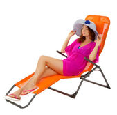 Beautiful girl in beach hat in lounge isolated on white — Stock Photo