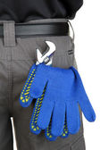 Gloves and instruments in back pocket close-up — Stock Photo