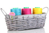 Bright threads in basket isolated on white — Stock Photo