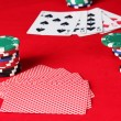 The red poker table with playing cards. A combination of four of a kind — Stock Photo
