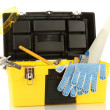 Open yellow tool box with tools isolated on white background — Stok fotoğraf