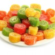 Colorful jelly candies on plate isolated on white — Stock Photo