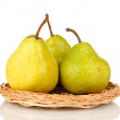 Ripe pears on wicker mat isolated on white — Stock Photo #13729038