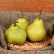 Ripe pears in sack on wooden background close-up — Stock Photo #13729045