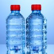 Stock Photo: Plastic bottles of water on blue background