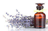 Lavender flowers and glass bottle isolated on white — Foto de Stock