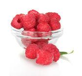 Fresh raspberries in bowl isolated on white — Stock Photo
