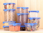 Filled plastic containers on wooden background — Foto de Stock