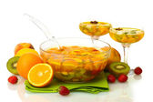 Punch in bowl and glasses with fruits, on wooden table, isolated on white — Stock Photo