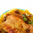 Whole roasted chicken with grapes, oranges and spices on blue plate on whit — Stock Photo