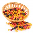 Colorful autumn berries in wicker basket isolated on white - Stock Photo