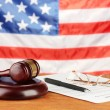 Stock Photo: Divorce decree and wooden gavel on americflag background