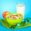 Tasty dieting food, fruits and glass of milk, on blue background — Stock Photo