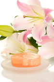 Beautiful lily and soap close-up — Stock Photo