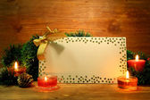 Beautiful Christmas composition with empty postcard on wooden background — Stock Photo