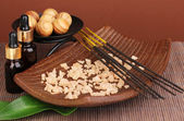 Aromatherapy setting on brown background — Stock Photo