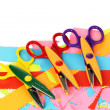 Colorful zigzag scissors with color paper isolated on white — Stockfoto