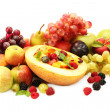 Fresh fruits salad in melon, fruits and berries, isolated on white — Stock Photo