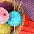 Royalty-Free Stock Photo: Colorful wool sweaters and balls of wool close-up