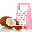 Stock Photo: Coconuts wirh pink grater isolated on white