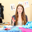 Beautiful young dressmaker in workroom - Stock fotografie