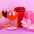 Colorful cocktails with bright decor for glasses on purple background with - 