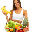 Beautiful young woman with fruits and vegetables in shopping basket, isolat — Stock Photo #13745095