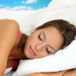 Young beautiful woman sleeping in bed — Stock Photo
