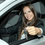 Beautiful young woman in car — Stock Photo #13745758