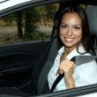 Beautiful young woman in car — Stock Photo #13745762
