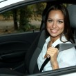 Stock Photo: Beautiful young woman in car