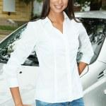 Beautiful young woman in car — Stock Photo #13745768