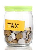 Glas bank voor tips met geld geïsoleerd op wit — Stockfoto