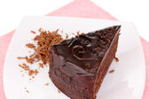 Chocolate sacher cake close-up isolated on white — Stock Photo