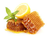 Sweet honeycombs with lemon and mint, isolated on white — Stock Photo