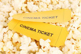 Cinema tickets on popcorn background — Stock Photo