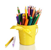 Colorful pencils and felt-tip pens in yellow pail isolated on white — Stock Photo