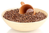 Coffee beans in bamboo bowl with cup isolated on white — Stock Photo