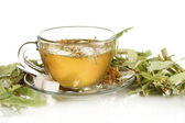 Glass cup of tea with linden isolated on white — Stock Photo