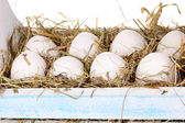 Eco-friendly eggs in wooden box close-up — Stock Photo