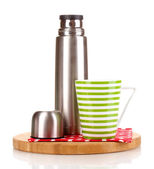 Metal thermos with cup on wooden board isolated on white — Stock Photo