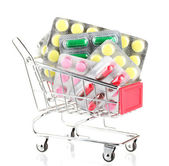 Shopping trolley with pills, isolated on white — Stockfoto