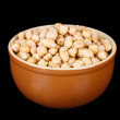Stock Photo: White chickpeas in brown bowl isolated on black