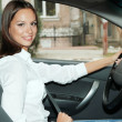 Beautiful young woman in car - Foto Stock