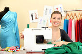 Beautiful young dressmaker in workroom — Photo