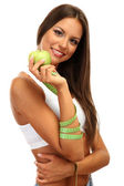 Beautiful young woman with green apple and measure tape, isolated on white — Stock Photo